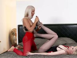 Shannon Reid and Ashley Bulgari are up for some foot joy as they relaxes on a soft bed. Shannon wears dark pantyhose and Ashley has red stockings. After thorough foreplay they divulge into passionate play.